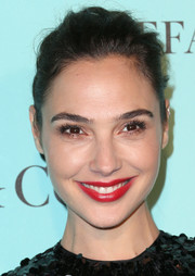 Gal Gadot brightened up her face with a glossy red lip.