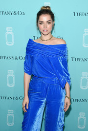 Ana de Armas was trendy in a blue velvet off-the-shoulder top and matching cargo pants by Monse at the Tiffany & Co. fragrance launch.