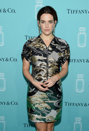 Riley Keough attended the Tiffany & Co. fragrance launch wearing a zip-front print dress by Louis Vuitton.