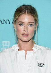 Doutzen Kroes kept it relaxed with this mildly messy ponytail at the Tiffany & Co. fragrance launch.
