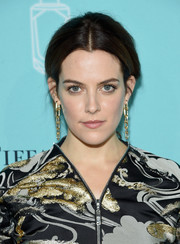 Riley Keough topped off her look with edgy-glam gold chain earrings by Tiffany & Co.