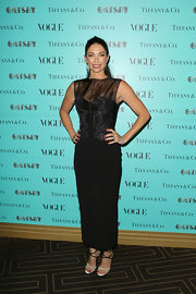 Erica Packer showed off her figure with this black sleeveless bustier dress that featured a long fitted skirt.
