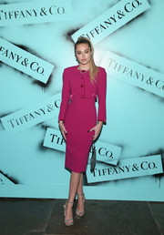 Delilah Belle Hamlin was svelte and chic in a fuchsia pencil dress and a matching bolero by Zac Posen at the Tiffany & Co. Modern Love photography exhibition.