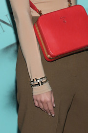 Emily Ratajkowski dazzled us with her Tiffany & Co. bangles during the brand's Modern Love photography exhibition.