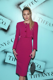 Delilah Belle Hamlin attended the Tiffany & Co. Modern Love photography exhibition carrying an elegant silver purse.