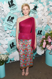 Greta Gerwig kept it classy in a wine-red one-shoulder peplum top by Delpozo at the Tiffany & Co. Paper Flowers event.