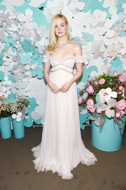 Elle Fanning looked ethereal in a flowing off-the-shoulder gown by Giambattista Valli Haute Couture at the Tiffany & Co. Paper Flowers event.