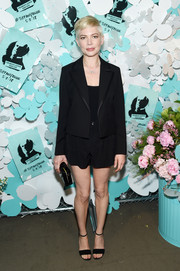 Michelle Williams donned a cropped jacket by Louis Vuitton for a more formal finish.