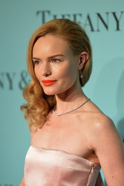 Kate Bosworth's bold orange lip provided a striking contrast to her delicate pink outfit.