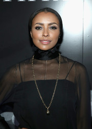Kat Graham's gold pendant necklace stood out so elegantly against her black outfit at the Tiffany HardWear Los Angeles preview.