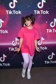 Baby Ariel dressed up as Boo from 'Monsters, Inc.' in a loose pink tee for the 2019 TikTok Halloween Party.