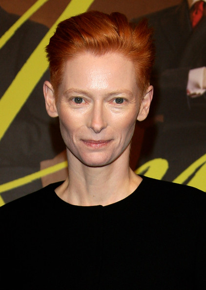 Tilda Swinton Fauxhawk [io sono lamore,hair,face,hairstyle,eyebrow,forehead,chin,blond,smile,quiff,premiere,milan screening,tilda swinton,actress,italy,milan,milan screening held at cinema colosseo on march 15]