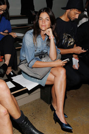 Julia Restoin-Roitfeld teamed her denim outfit with metallic blue Saint Laurent kitten heels.