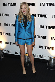 Amanda Seyfried showed off her legs at the UK 'In Time' premiere in an electric blue short suit with black contrast piping.