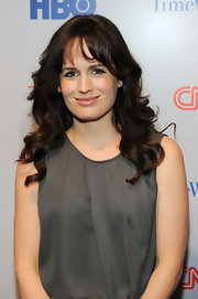 Elizabeth Reaser's lovely locks held just the right amount of wave at the Beyond 9/11 photo exhibit and screening. Elizabeth's look can be recreated using a large-barreled curling iron, curling one-inch sections and  adding just a slight bend to bangs. Instead of brushing, tousle curls with fingers.