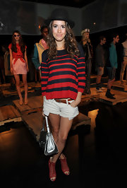 Louise Roe stepped out in style in a pair of red gladiator sandals.