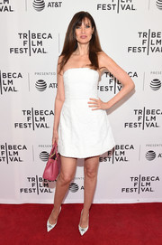 Carol Alt styled her dress with a pair of studded white pumps.