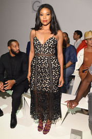 Gabrielle Union made a chic appearance at the Todd Snyder fashion show in a black lace cocktail dress by Self-Portrait.