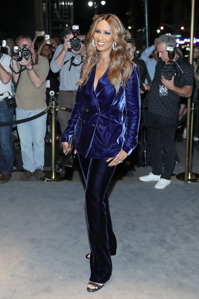 Iman was androgynous-chic in a purple velvet pantsuit by Tom Ford while attending the label's fashion show.