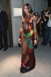 Naomi Campbell made jaws drop at the Tom Ford fashion show with this multicolored sequin gown from the label, boasting a bodice that skewed dangerously close to a wardrobe malfunction!