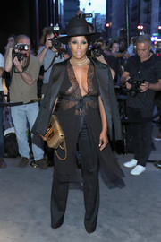 June Ambrose suited up in black for the Tom Ford fashion show.