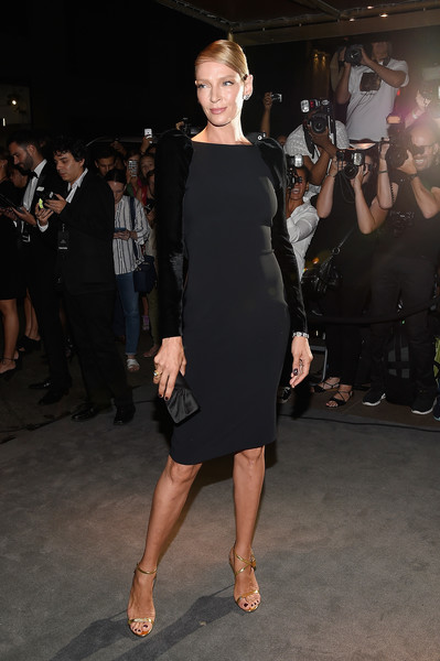 Uma Thurman went for simple elegance in a Tom Ford LBD with long velvet sleeves when she attended the label's fashion show.