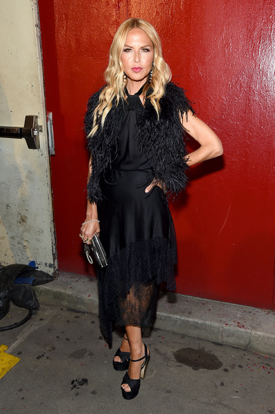 Rachel Zoe donned a black lace-hem halter dress for the Tom Ford fashion show.