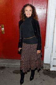 Diane von Furstenberg topped off her outfit with a cropped patent jacket.