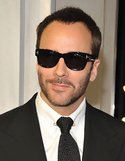 Tom Ford's black Wayfarer shades were a classic and sophisticated choice for the fashion designer.