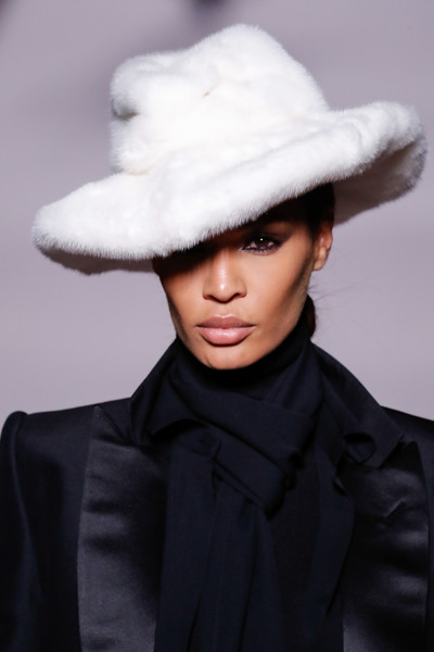 Joan Smalls looked winter-glam with her white fur hat at the Tom Ford fashion show.