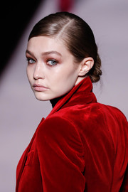 Gigi Hadid walked the Tom Ford Fall 2019 runway wearing her hair in a side-parted chignon.