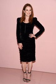 Julianne Moore attended the Tom Ford Spring 2018 show wearing a ruched black velvet dress from the brand.