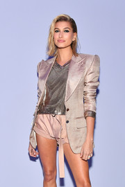 Hailey Baldwin attended the Tom Ford fashion show rocking a silver chainmail tunic from the label.