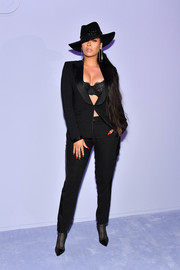 La La Anthony wrapped up her curves in a black Tom Ford pantsuit and a matching lace bra for the label's Fall 2018 show.
