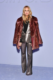 Rachel Zoe donned a wine-red fur coat for added glamour to her gold suit.