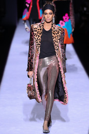 Joan Smalls showcased her shapely legs in a pair of rose-gold leggings at the Tom Ford runway show.