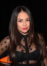 Janel Parrish wore her tresses in sleek, face-framing layers during the Tommy Bahama private event.