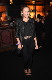 Lauren Conrad rocked an all-black leather jacket, crop-top, and jeans combo at the Tommy Bahama private event.