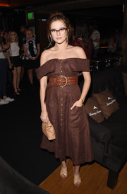 Zoey Deutch looked effortlessly stylish in a brown button-down off-the-shoulder dress at the Tommy Bahama private event.