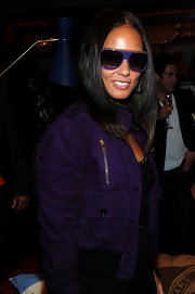 Alicia showed off her love of purple in this suede bomber jacket and purple oval shades. We love the shades, but the matching jacket was a little overpowering.