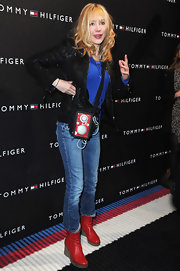 Julie Depardieu donned red, white and blue for the Tommy Hilfiger Flagship opening. She paired her outfit with red leather wedge boots.