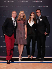 Cash Warren went for some classic elegance at the Tommy Hilfiger store opening with a sleek black suit.