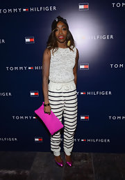 Estelle's sleeveless knit top was preppy and classic when paired with striped pants.
