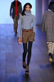 Chanel walked the runway in a baby blue angora cable-knit sweater for Tommy Hilfiger.