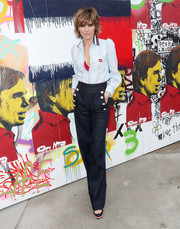 Lisa Rinna teamed her shirt with high-waisted nautical jeans.