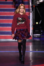 Georgia May Jagger was all bundled up in an embroidered maroon sweater on the Tommy Hilfiger runway.