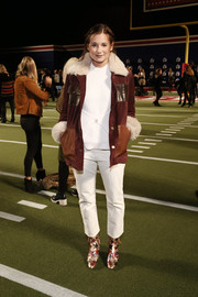 Danielle Bernstein was tough-chic at the Tommy Hilfiger fashion show in a brown utility jacket with a fur collar and cuffs.
