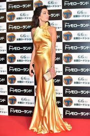 Amal Clooney radiated at the 'Tomorrowland' Tokyo premiere in a marigold Maison Margiela gown that flowed fluidly down her slim frame.