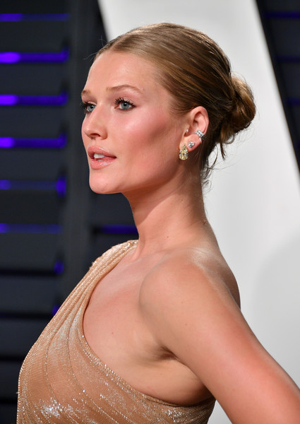 Toni Garrn Classic Bun [oscar party,vanity fair,hair,hairstyle,shoulder,beauty,eyebrow,chin,blond,chignon,neck,long hair,beverly hills,california,wallis annenberg center for the performing arts,radhika jones - arrivals,radhika jones,toni garrn]