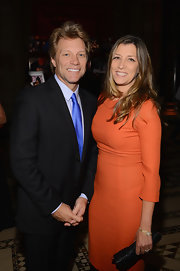 Dorothea Hurley wowed the crowd with a classic orange evening dress at the Exploring The Arts Gala.